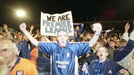 Town fans celebrate on the Portman Road pitch after beating Bolton in the classic play-off semi-fina