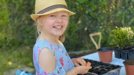 Gardening makes Florence, aged nine, feel happy Picture: KATE ROSTEN