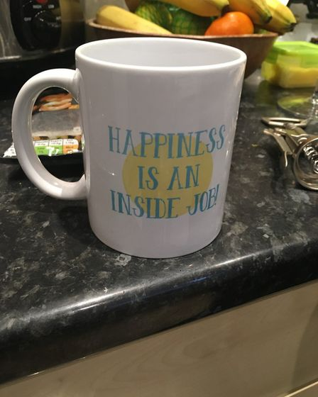 Sam Brook's mug carries a message about happiness Picture: SAM BROOK