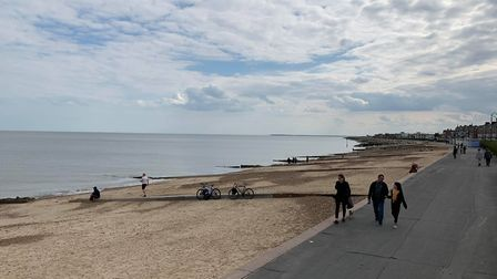 Families walk on Felixstowe's beachfront Picture: SARAH LUCY BROWN
