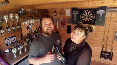 Michael Thoroughgood and his partner Stephanie Elsey in the 'Thoroughgood's pub' at their home in Bo