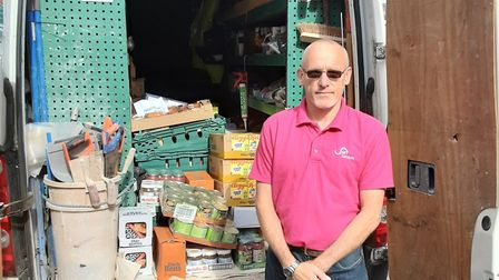 Jonathan Callum, a kitchen fitter at Flagship Group, delivering food packages during the coronavirus