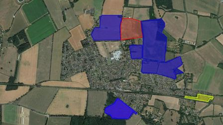 A map of Thurston where areas in blue have already had housing plans approved, an area in red where