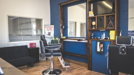Two barbers are ready and waiting for all the overdue haircuts that will be in dire need after the l