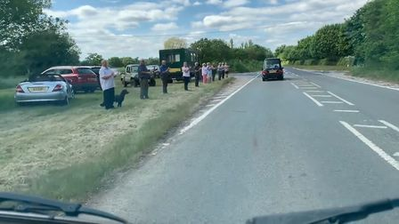 Two groups of mourners filled the village of Hessett and the road outside West Suffolk crematorium t