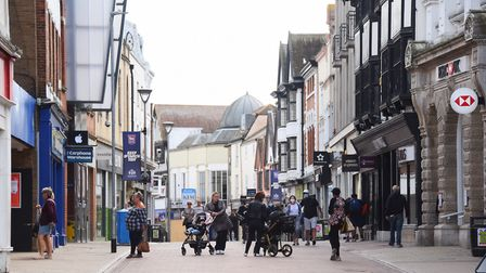 A few people out and about queuing for the pharmacy in Ipswich town centre on Saturday. Picture: DEN