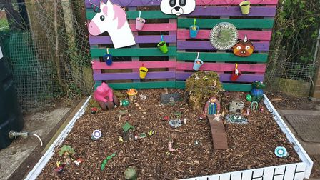 Karly Chambers and her three daughters - Izzy, Amber and Lola Minchin - have created this fairy gard