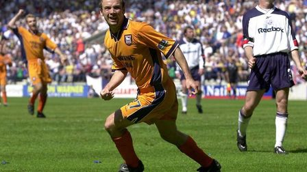 Marcus Stewart scored some vital goals on the way to promotion, including this one at the Reebok Sta