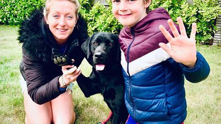Laura Ripman and her son Olly take part in the #Gimme5 challenge with their labrador Sky Picture: SU
