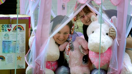 Louise and Hollie Thearle with unicorns in their Fulcher Close front garden Picture: ANDY ABBOTT