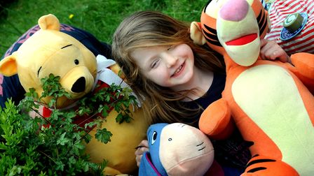Seven-year-old Molly Adcook with her Winnie the Pooh front garden in Fallowfield Walk Picture: ANDY