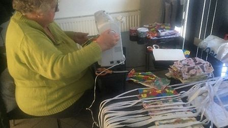 Christine Bailey busy making scrubs and masks for the NHS Picture: STEVE BAILEY