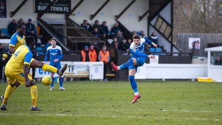 Ross Crane fires in a cracking goal for Bury Town last season Picture: NEIL DADY