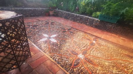 The garden path, stone walls and fancing are all made almost exclusively from recycled materials Pic