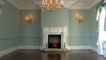 A yet-to-be furnished living room, complete with miniature fireplace Picture: Emma Waddell