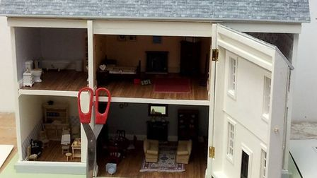 A work in progress - with scissors showing the scale of how small dolls houses are Picture: Emma Wad