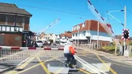 The shocking dashcam footage taken in Colchester shows the cyclist risk his life to go over the leve
