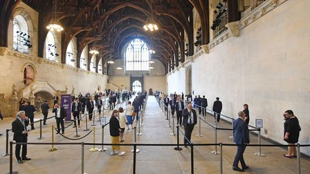 MPs queue in Westminster Hall to vote on banning electronic voting in the House of Commons: UK Parli