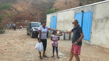 Jack Lillingston has been helping Colombian locals by handing out food parcels while stuck in the co