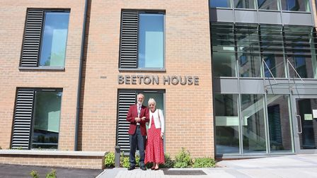 Nigel and his wife Carol are pictured outside one of the new accommodation blocks opened at the hosp