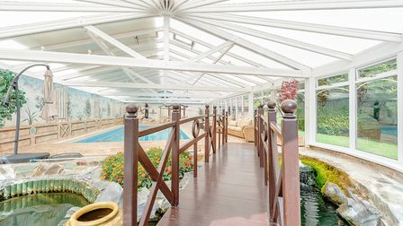 The property, on the Suffolk Essex border, has an extensive indoor pool complex Picture: STRUTT & P