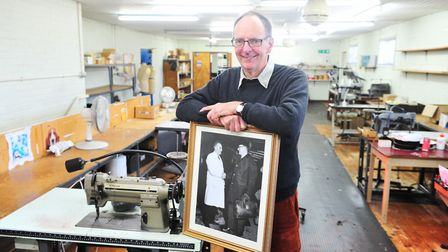 Tim Nursey with a photo of his father Samuel Burton Nursey before the workshop was due to close down