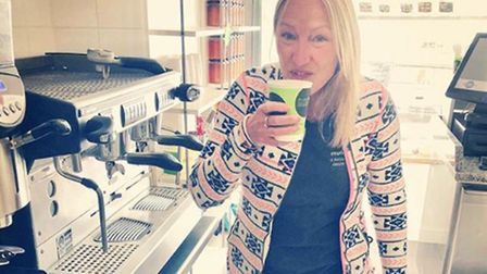 Susie Medland of Aldeburgh Munchies enjoying her first coffee as the cafe reopened as a takeaway Pic