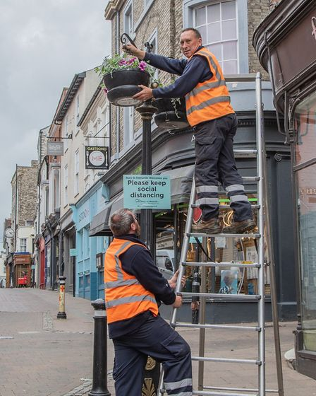 The return of the floral displays around the town centre coincides with the opening of shops and bus