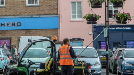 Putting up the hanging baskets is a massive piece of logistical planning Picture: JO SWEETMAN