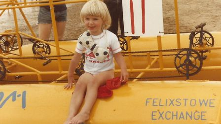 Clare Carver, aged two, sitting on the British Telecom team's raft for Felixstowe Raft Race in 1981