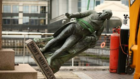 Workers take down a statue of slave owner Robert Milligan at West India Quay Picture: Yui Mok/PA Wir
