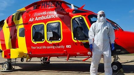 Dr Chris King of Essex and Herts Air Ambulance wearing PPE. The Lions Clubs have donated almost £10,