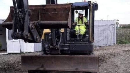 Chloe driving a digger on a building site, showing that diabetes doesn't need to get in the way of y