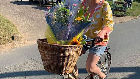 Victoria delivering flowers on her bike throughout her local community Picture: Victoria Orves Marsh