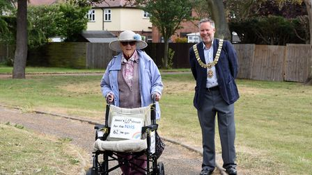 Felixstowe mayor Mark Jepson joined Joan Rich from a distance as she completes a lap of Allenby Park