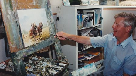 John Constable Reeve working on a painting in his studio at his farm in Mettingham Photo: The Reeve