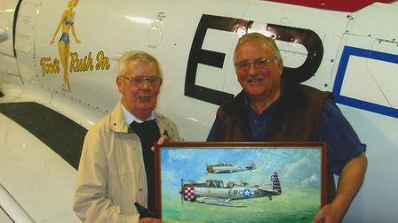 John Constable Reeve handing over a painting to Maurice Hammond author of books on US aircraft in th