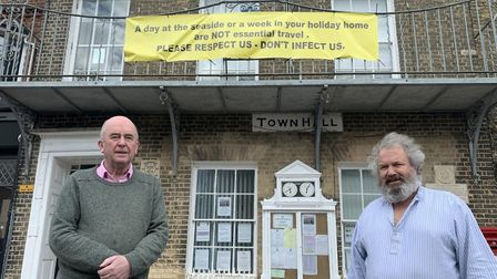 Southwold town councillors Simon Flunder and David Beavan with the banner which was temporarily put