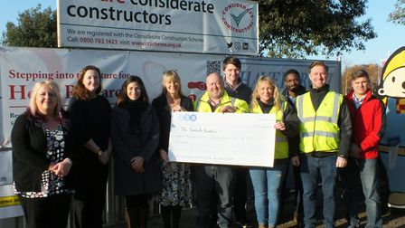 Members of The Somerville Foundation being presented with the cheque from Havercroft Construction Pi