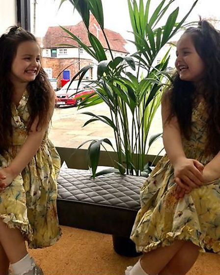 Charlotte Taylor's identical twins Missy (left) and Gracie (right) who the salon is inspired by. Pic