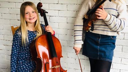 Bella and Millie Wood play their instruments on the track Picture; JAMIE WOOD