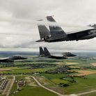 F-15E Strike Eagles assigned to the 494th Fighter Squadron perform a missing-man formation in memory