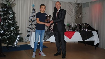 Stephen Williams, right, presenting an award to young Saint Edmund Pacer Lewis Sullivan