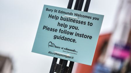 Signs have been put up around Bury St Edmunds reminding people to help businesses with their new gu