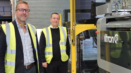 Fencor Packaging's new digital cutting machine installed at Mildenhall with director Chris Hall, lef
