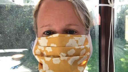 Claire Pike of Sew Soft Furnishing in Capel St Mary wearing one of the masks she makes Picture: SEW