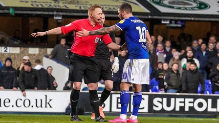 James Norwood disagreeing with referee Alan Young after he had disallowed Luke Chambers' first half