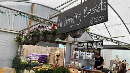 Hanging baskets for sale near the till Picture: The Potting Shed