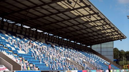 Cardboard cutout pictures of fans in the stands during the Sky Bet League Two play-off semi final fi