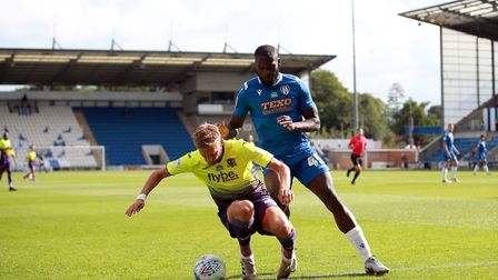 Colchester Uniteds Frank Nouble (right) and Exeter Citys Dean Moxey battle for the ball during the